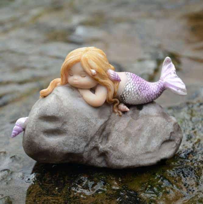 rock with sleeping mermaid