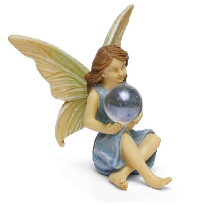 fairy figurine holding orb