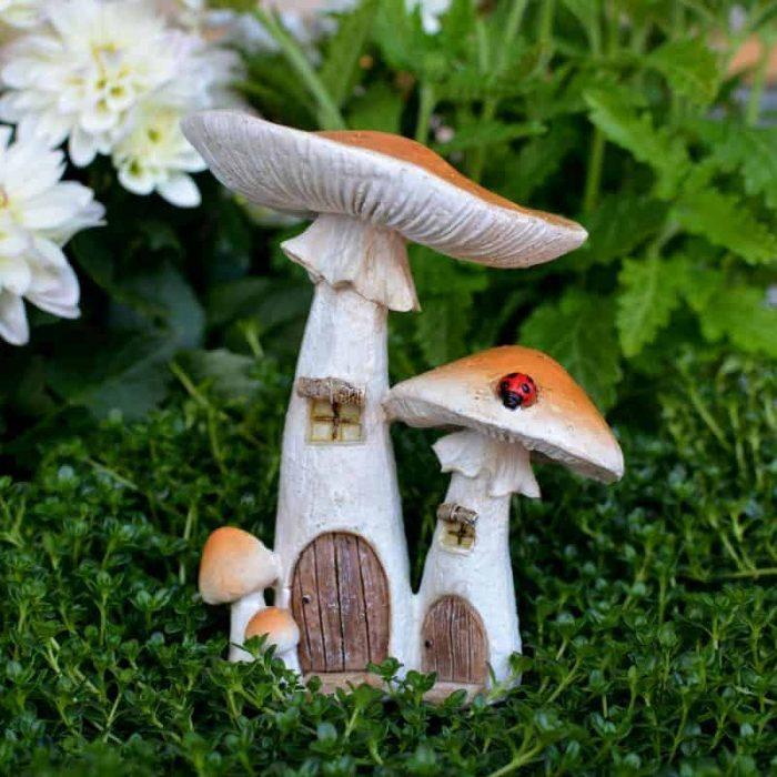 yellow fairy house, mushroom design with ladybug