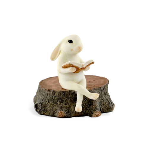 Bunny Reading on a Stump