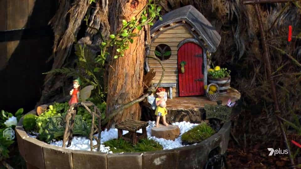 snail cove cottage in fairy garden