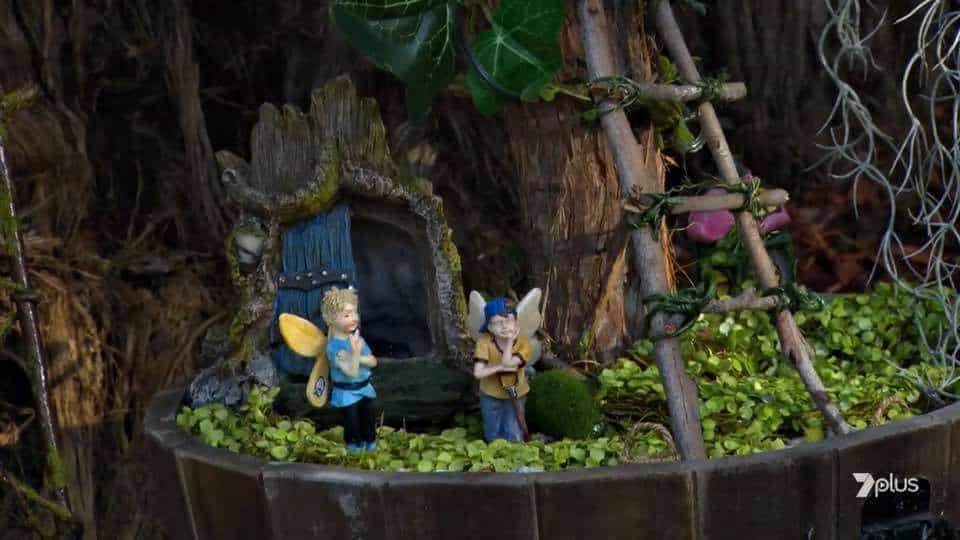 boy fairy figurines with fairy house