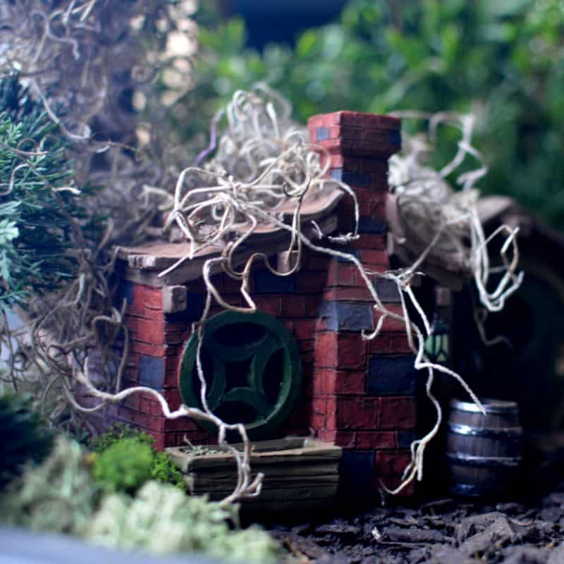 brick fairy house with moss