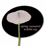 spring mounted wobble top