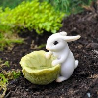 rabbit figurine with cabbage