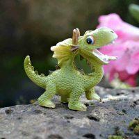 green happy dragon figurine